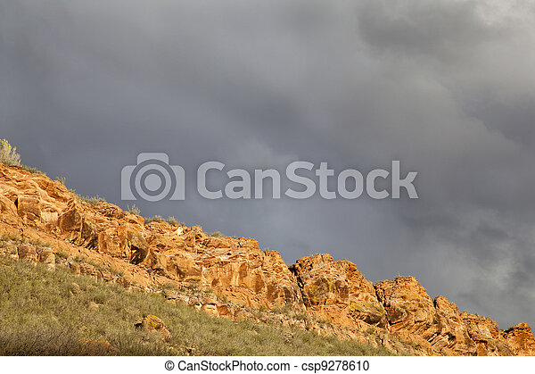 stormy sky over sandstone cliff - csp9278610