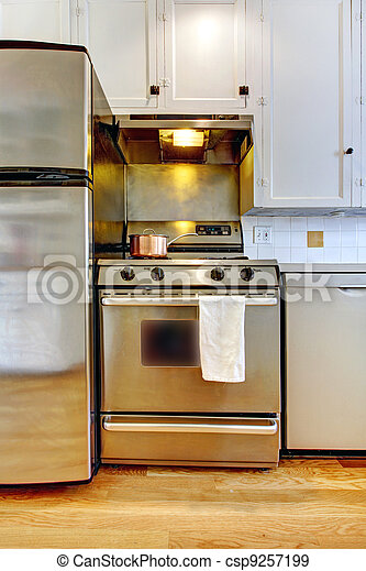 Stove and refrigerator in stainless steal with white kitchen. - csp9257199