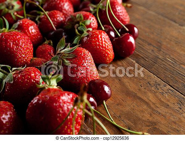 strawberries and cherries - csp12925636