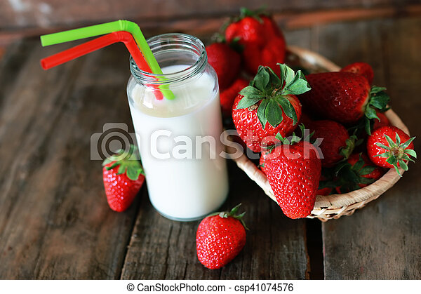 strawberries and milk in a glass - csp41074576
