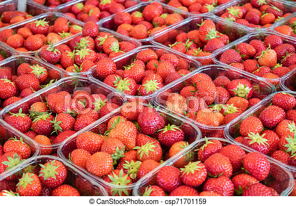 Strawberries In Plastic Containers At Farmers Market Background Texture