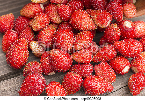 Strawberries on rustic wooden background - csp49398998