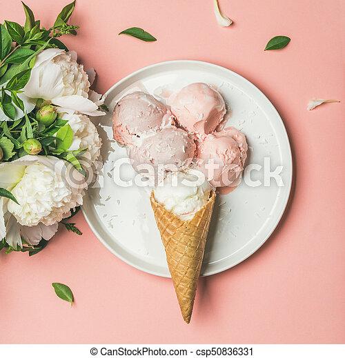 Strawberry and coconut ice cream, cones, white peonies, square crop - csp50836331