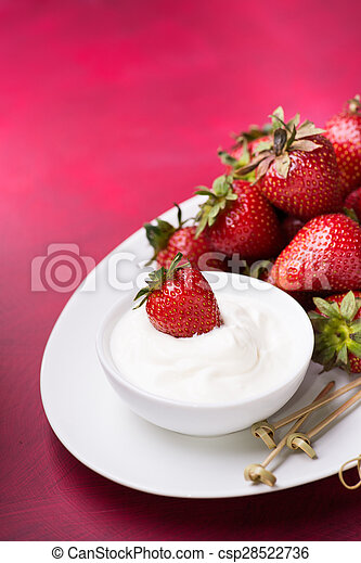 Strawberry in a bowl with cream - csp28522736