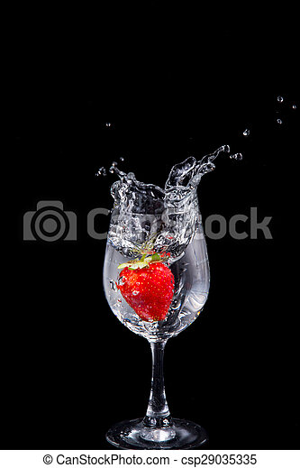 ef2444540a8f Strawberry in wine glass on a black background - csp29035335