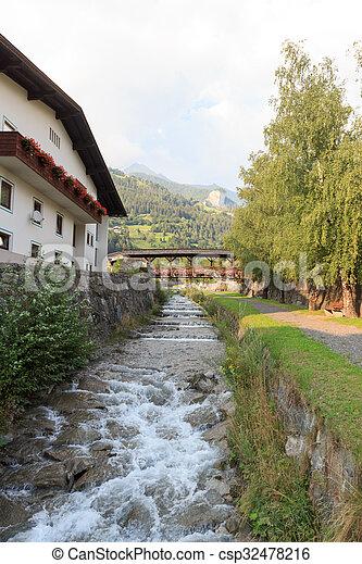 Stream Bretterwandbach with bridge in Matrei in Osttirol, Austria - csp32478216