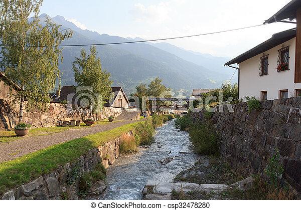 Stream Bretterwandbach with bridge in Matrei in Osttirol, Austria - csp32478280