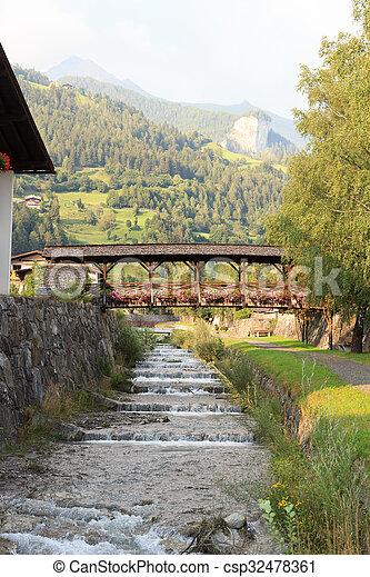 Stream Bretterwandbach with bridge in Matrei in Osttirol, Austria - csp32478361