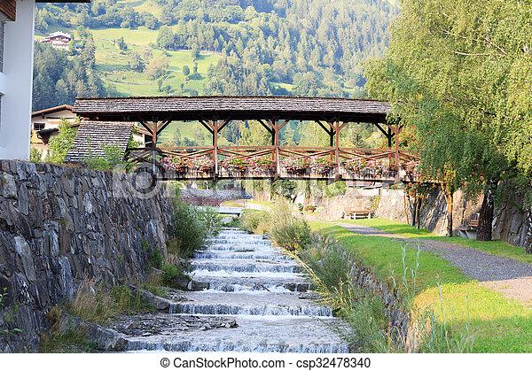 Stream Bretterwandbach with bridge in Matrei in Osttirol, Austria - csp32478340