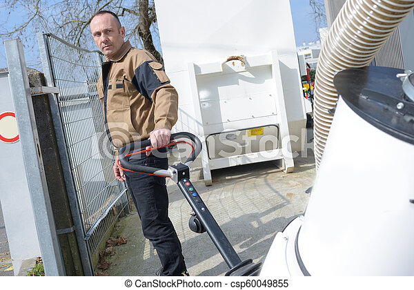 street cleaner man with its equipment - csp60049855