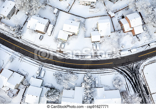 street in a residential area after heavy snowstorm - csp91627771