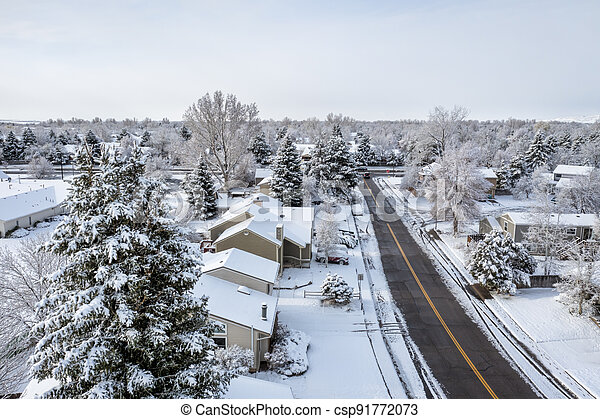 street in a residential area after heavy snowstorm - csp91772073