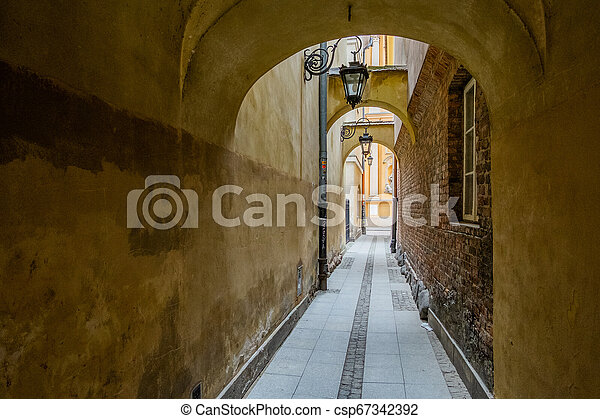 Street in Old Town of Warsaw, Poland - csp67342392