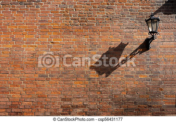 Street lamp on a brick wall - csp56431177