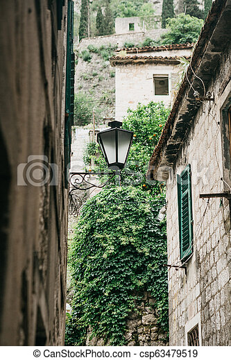 Street lamps on the outside of a stone apartment building - csp63479519