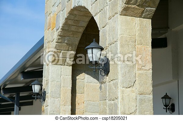 Street lanterns on the wall of a st - csp18205021