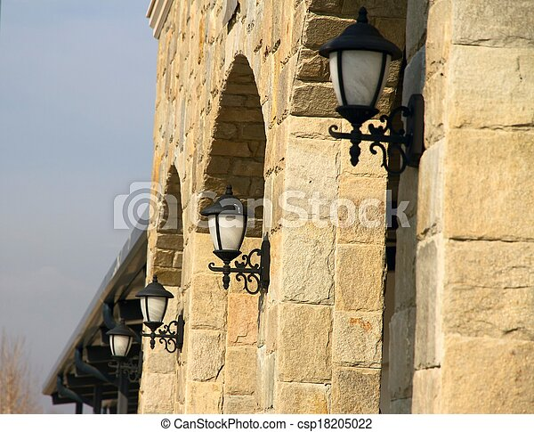 Street lanterns on the wall of a st - csp18205022