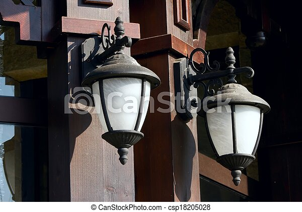 Street lanterns on the wall of a st - csp18205028