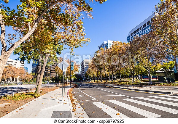 Street lined up with Sycamore trees close to downtown San Jose; office buildings visible on both sides; Silicon Valley, south San Francisco bay area - csp69797925