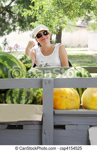 Street melons vendor at counter - csp4154525