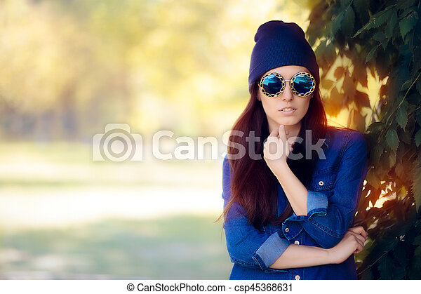 Street Style Fashion Girl In Denim Shirt Wearing Blue Sunglasses