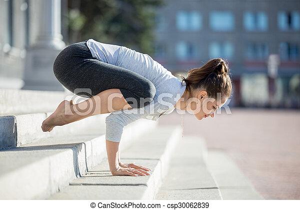 street yoga bakasana yoga in the city beautiful young