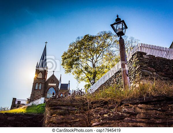 Streetlight and St. Peter's Roman Catholic Church, in Harper's Ferry, West Virginia. - csp17945419