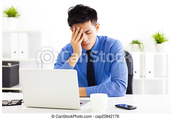 stressed business man in the office - csp23842176