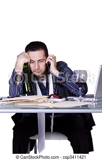 Stressed Businessman at His Desk Working - csp3411421