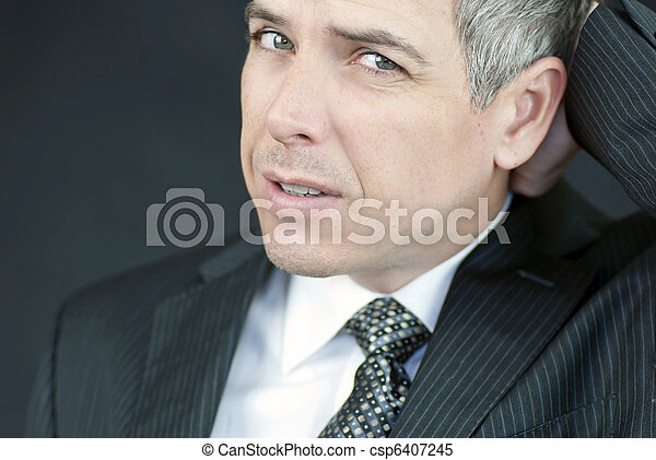 Stressed Businessman Looks To Camera - csp6407245