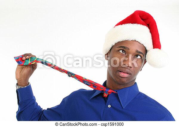 Stressed or Worried Man in Santa Hat - csp1591000