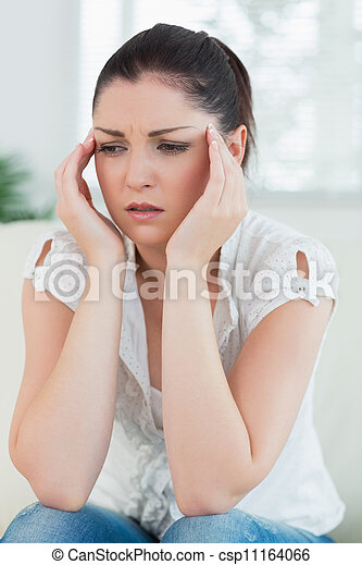 Stressed woman sitting on the couch - csp11164066