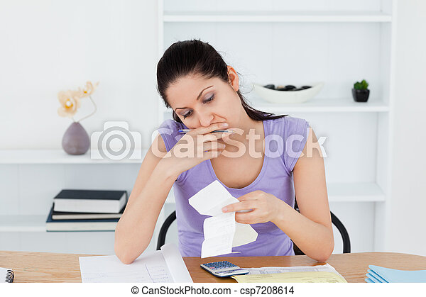 Stressed young woman doing banking - csp7208614
