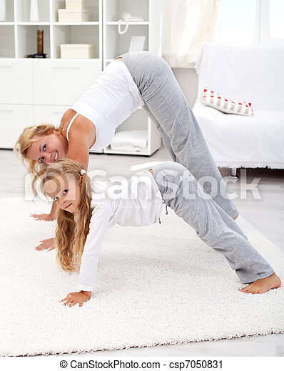 Stretching with mom in the morning - csp7050831
