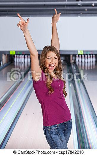 Strike! Teen girl rejoicing at a strike. - csp17842210