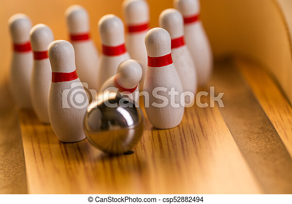 striking bowling ball