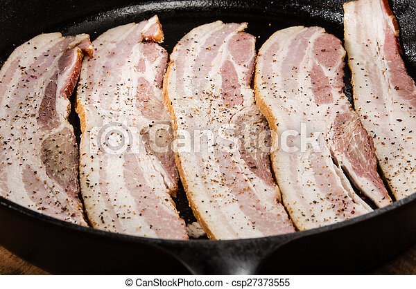 Strips of raw bacon ready to fry - csp27373555