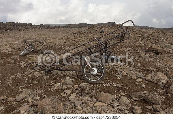 Stroller, stretcher lie on the stones - csp47238254