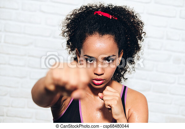 Strong African American  Black Woman Fighting For Self Defense - csp68480044
