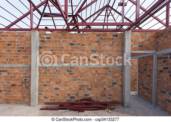 Structural Steel Beam On Roof And Brick Wall Of Building
