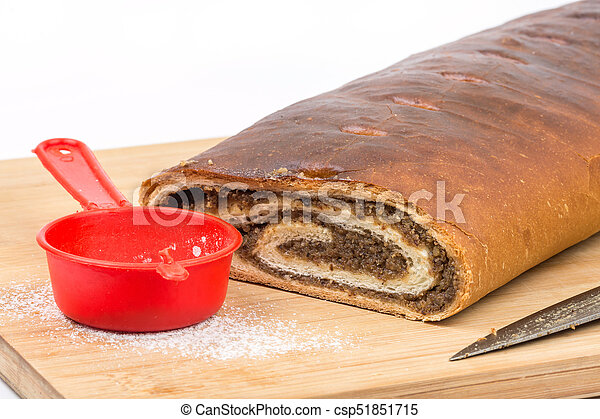 Strudel with walnuts on the wooden board - csp51851715
