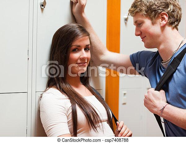 Student couple flirting - csp7408788
