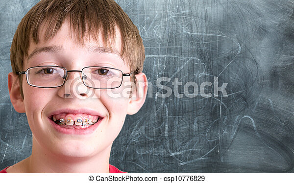Student In front of Chalkboard - csp10776829