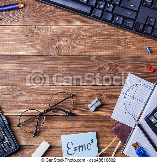 https://comps.canstockphoto.com/student-material-on-wooden-table-with-stock-photography_csp48816802.jpg