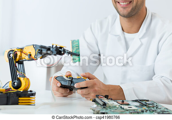 Student of technology using a modern robotic arm - csp41980766