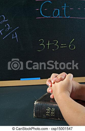 student praying in school - csp15001547