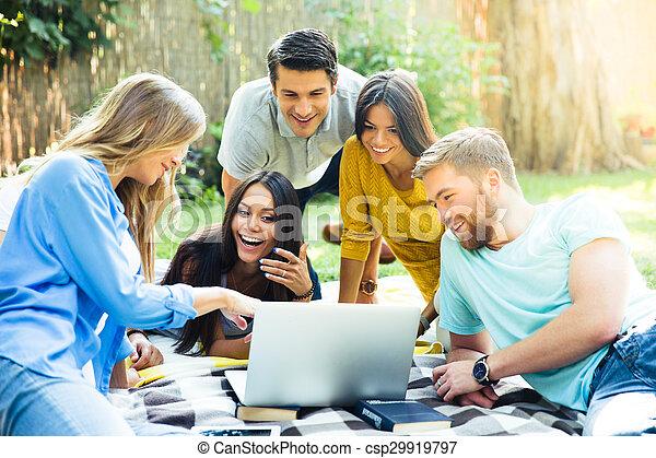 Student using laptop in campus - csp29919797