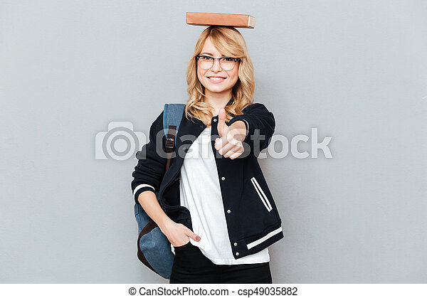 Student with book on head - csp49035882