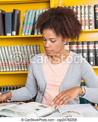 Student With Books Studying At Table In Library - csp24782258
