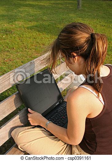 Student working on laptop - csp0391161